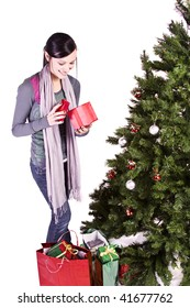 Beautiful Girl by the Christmas Tree - Isolated