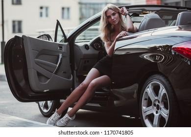 beautiful girl in a beautiful cabriolet car