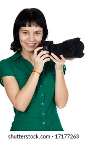 Beautiful girl with camera on a white background