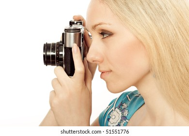 beautiful girl with a camera taking a photo
