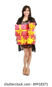 Beautiful girl carrying stack of gift box. Isolated.