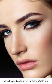 Beautiful girl with cat eye make-up