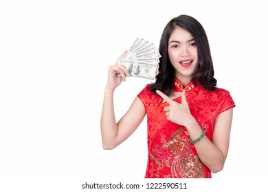 beautiful girl in the Cheongsam red dress up holding money on white background, The symbol of Chinese New Year
