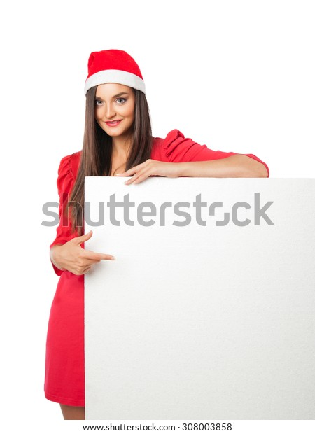 beautiful girl in a Christmas costume is holding styrofoam and points a finger at him