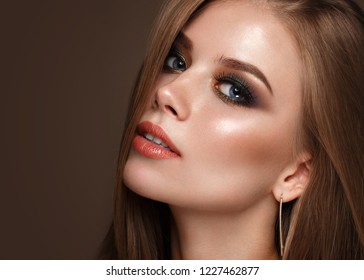 Beautiful girl with classic colorful make up.. Beauty face. Photos shot in studio