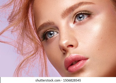 Beautiful girl with classic make up on a bright background. Beauty face. Photo taken in the studio