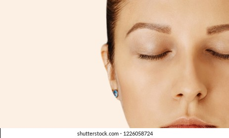 Beautiful girl with closed eyes and perfect skin with natural make-up. Natural beauty, cosmetology and skin care. Close up, macro with copy space