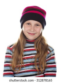Beautiful girl in colored striped hat and sweater on a white background.