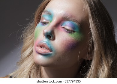 beautiful girl with colorful face and flowers