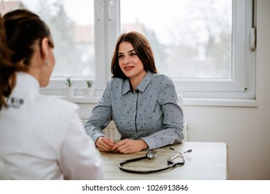 Beautiful girl is consulting with gynecologist