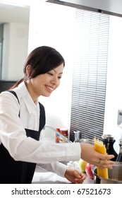 beautiful girl cooking pasta in the kitchen