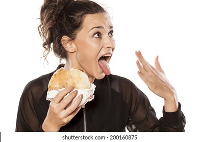 beautiful girl cooling with her ??hand her tongue because of spicy sandwich