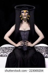 Beautiful girl in corset and gray mask