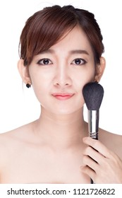 Beautiful girl with cosmetic powder brush for make up.