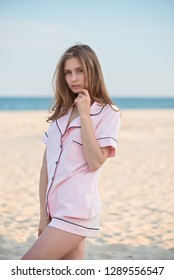 beautiful girl in cotton home costume against the sea