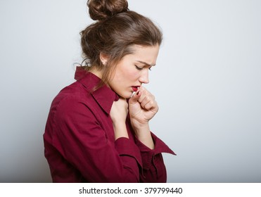 Beautiful girl coughing isolated on a gray background