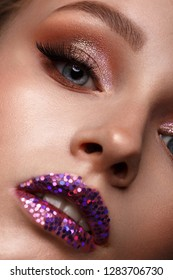 Beautiful girl with creative glitter make-up. Beauty face. Photos shot in studio