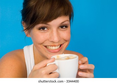 a beautiful girl with a cup of coffee