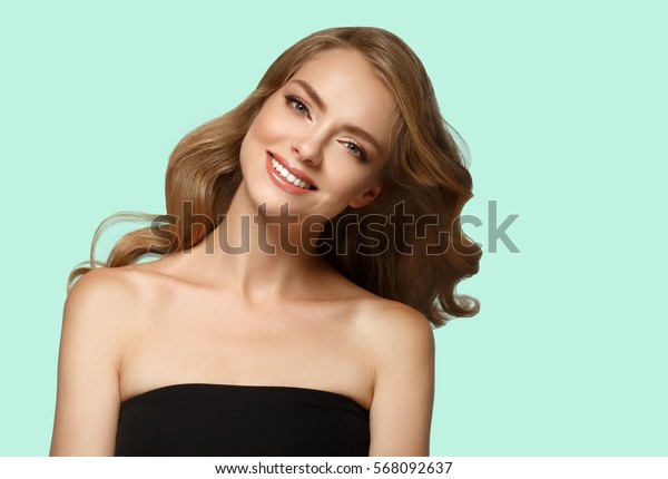 Beautiful girl curly blond hair on summer green trendy color background.