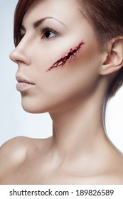 beautiful girl with a cut on face