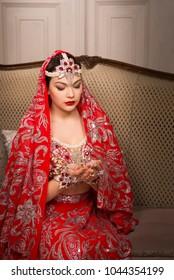 Beautiful girl dances in a red sari.