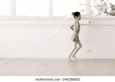 Beautiful girl dancing balet with ribbon