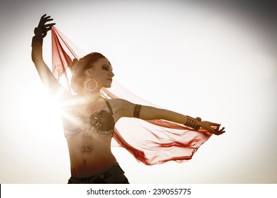 Beautiful girl dancing ethnic dances in desert