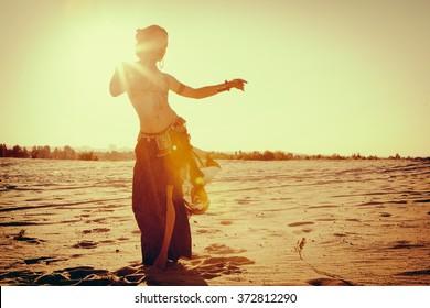 Beautiful girl dancing ethnic dances in desert