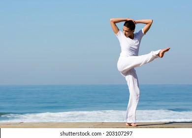beautiful girl dancing on the beach