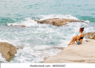 d75f8ba102a6 woman on stormy tropical beach Images