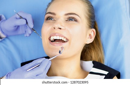 beautiful girl in the dental chair on the examination at the de