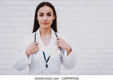 Beautiful Girl Doctor. Medicine in Hospital. Health People in Clinic with Good Doctor. Therapy for Illness PEople. Hope in Hospital for People. Service Room in Clinic with Nurse. Pediatrician Work.