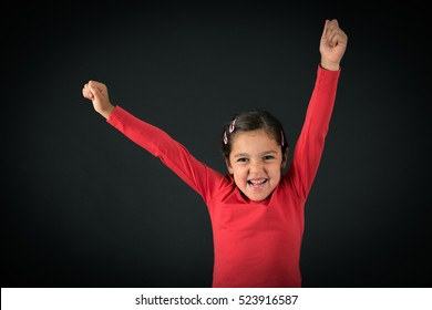 Beautiful girl doing different expressions in different sets of clothes: arms raised
