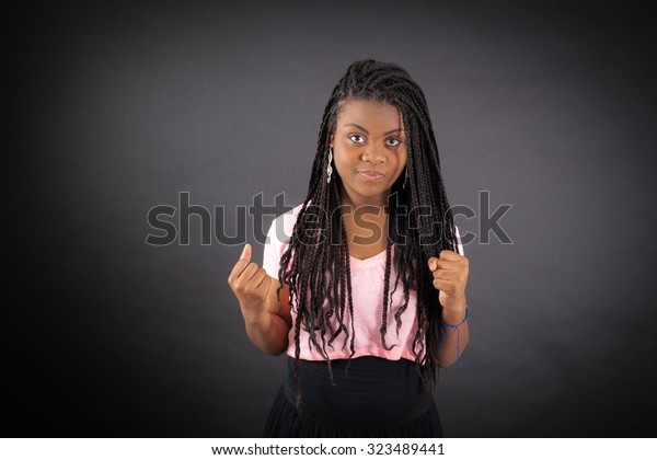 Beautiful girl doing different expressions in different sets of clothes: angry