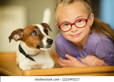 Beautiful girl with a Down syndrome with her pet Jack Russell Terrier