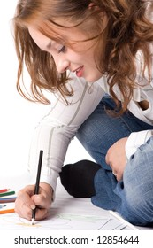 Beautiful girl is drawing with crayons. Isolated on white. #4