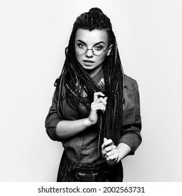Beautiful girl with dreadlocks. Business portrait for a creator, artist, musician. Wild beauty. Original ethnic style.