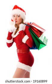beautiful girl dressed like Santa with Christmas presents