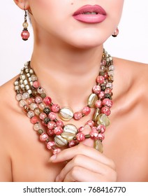 beautiful girl dressed in luxurious handcrafted necklace accessories and beautiful earrings