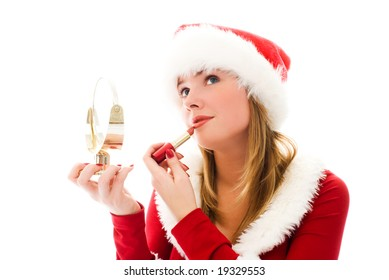 beautiful girl dressed as Santa painting her lips