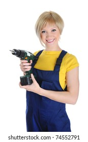 Beautiful girl with a drill in building overalls. Isolated on white background