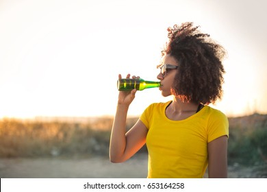 Beautiful girl drinking a beer