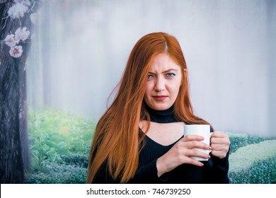 Beautiful girl drinking coffee at the coffee shop