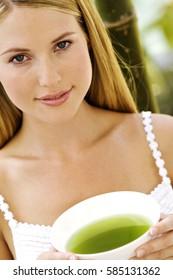 Beautiful Girl Drinking Healthy Green Tea