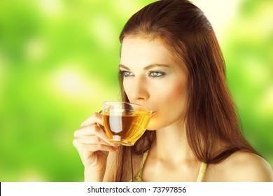 Beautiful Girl Drinking Healthy Green Tea. Healthcare or Herbal medicine concept