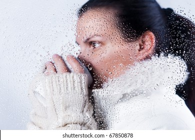 Beautiful girl drinking hot beverage on winter
