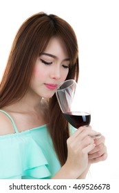 Beautiful girl drinking red wine isolated on white background