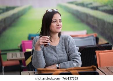Beautiful girl drinking tea at the coffee shop