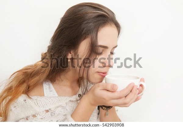 Beautiful Girl Drinking Tea or Coffee on a white Background