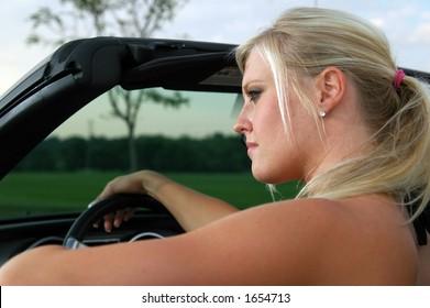 Beautiful girl driving sports car